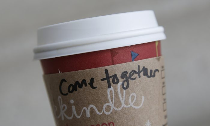 A cup of coffee with the words 'come together' is seen at the Union Station location of Starbucks, on December 27, 2012 in Washington, DC. Free coffee will be given to anyone who buys another person their favorite beverage, from Oct. 9 to Oct. 11, 2013. (Drew Angerer/Getty Images)