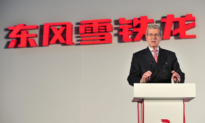 Philippe Varin, CEO of PSA Peugeot Citroën gives a speech at a new Dongfeng Peugeot-Citroën Automobile Limited (DPCA) plant in Wuhan, central China, July 2, 2013. (AFP/AFP/Getty Images)