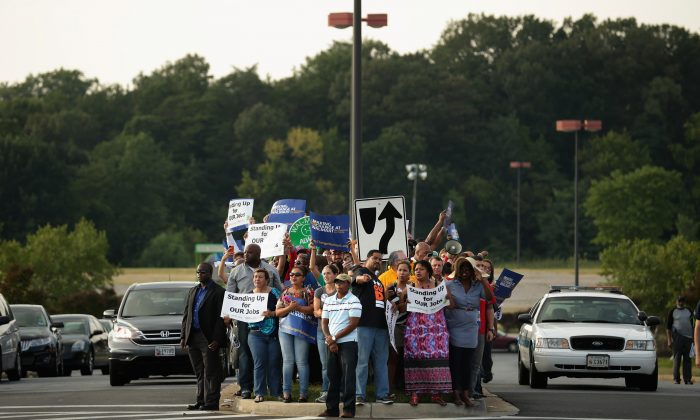Hundreds of demonstrators march and block traffic in a major intersection outside a Walmart store Sept. 5, 2013 in Hyattsville, Maryland, to protest the retail giant's labor practices. (Chip Somodevilla/Getty Images)