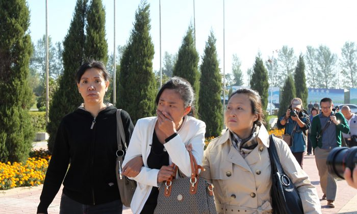 Zhang Jing (C), the wife of the 36-year-old street vendor Xia Junfeng, weeps as she arrives at the Dongling Funeral Home on Sept. 26, 2013, in Shenyang, China, to retrieve the ashes of her husband. Three high-profile cases in the last week of September, including Xia's, ere decided according to the political needs of the Chinese regime, according to Heng He. (ChinaFotoPress/Getty Images)