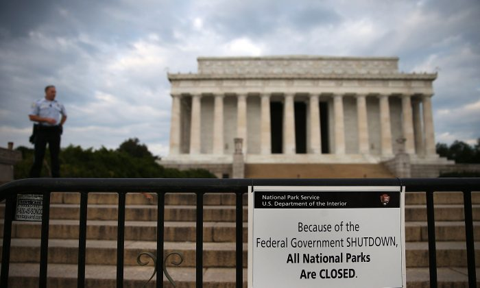 A U.S. Park Police officer stands guard in front of the closed Lincoln Memorial, Oct. 1, 2013 in Washington, D.C. Despite being shut out of their favorite public monuments, Chinese tourists are learning about America's independence from its government. (Mark Wilson/Getty Images)