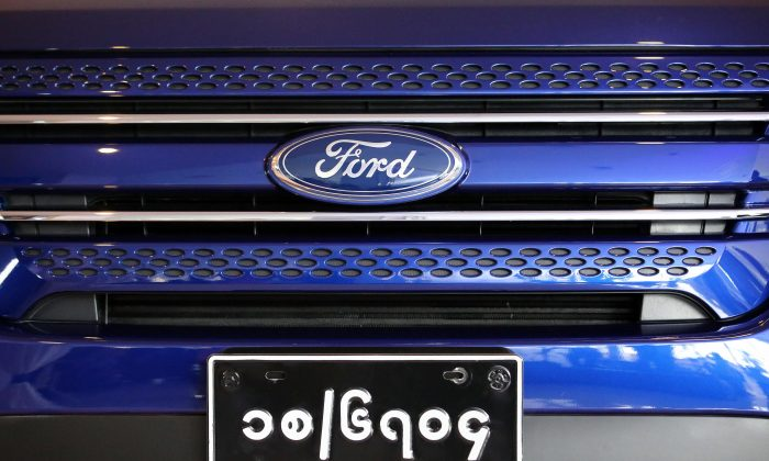 A Ford car carrying a Burma plate at a Ford showroom in Yangon, Burma, Oct. 4. (Ye Aung Thu/AFP/Getty Images)