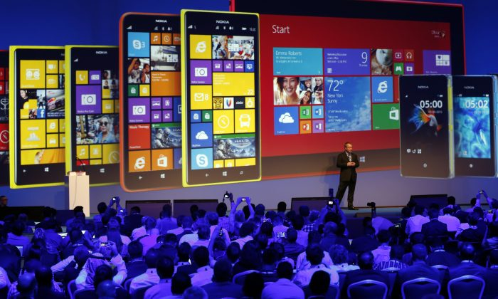 Stephen Elop unveils Nokia's latest products during an event in Abu Dhabi, Oct. 22. (KARIM SAHIB/AFP/Getty Images)