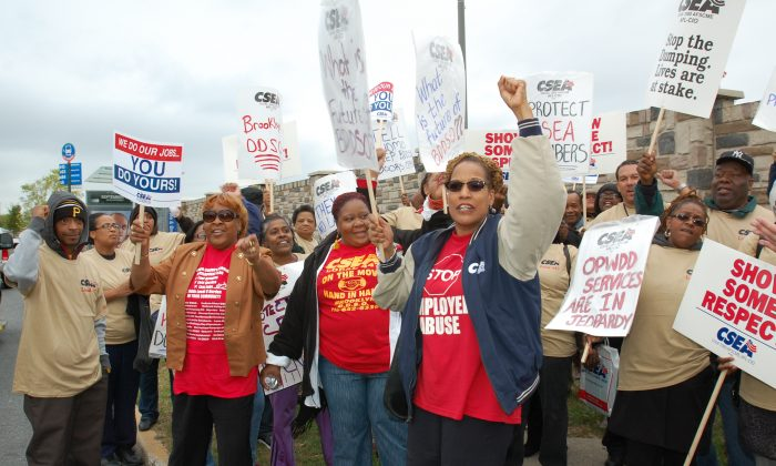 Brooklyn Developmental Center staff and supporters protest outside the facility in Brooklyn, New York, on October 10, 2013. (Courtesy of David Galarza)