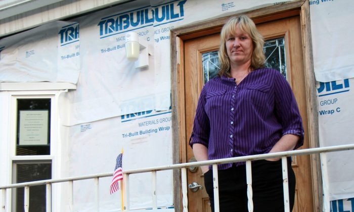 Deirdre Young-McGrath stands outside her home in New Dorp Beach, Staten Island, New York, on Oct. 15, 2013. (Ivan Pentchoukov/Epoch Times)