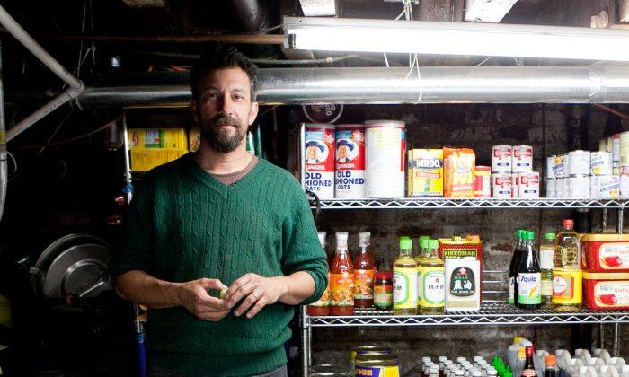 Ben Schneider, co-owner of the Good Fork restaurant, in his kitchen in Red Hook, Brooklyn, New York, Oct. 15, 2013. (Samira Bouaou/Epoch Times)