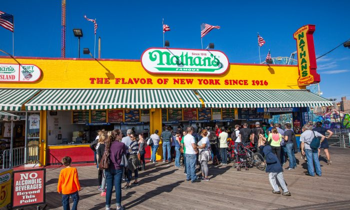 Customers wait in line for a hot dog from Nathan's Famous on Coney Island, Brooklyn, New York, Oct. 17, 2013. (Petr Svab/Epoch Times)