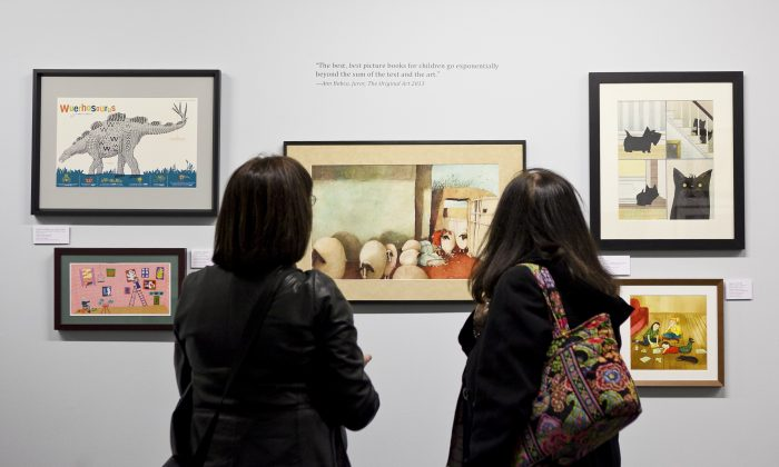 Visitors view this year's Original Art exhibit at the Society of Illustrators. (Samira Bouaou/Epoch Times)