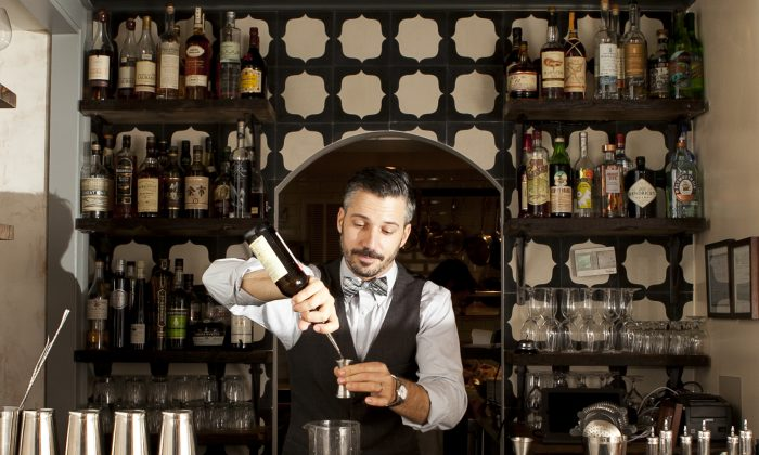 Xavier Herit making cocktails at his new bar, Wallflower, which opened in the West Village on Oct. 22. (Samira Bouaou/Epoch Times)