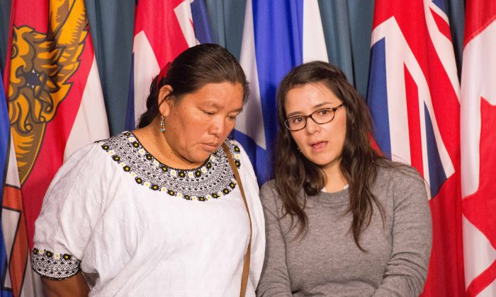 Valeria Scorza (R), deputy director for Mexican mining NGO Prodesc, translates for Angelica Choc, whose husband was killed by security staff at HudBay Minerals Fenix Mining Project in Guatemala. Choc, along with 13 other Mayan Guatemalans, is suing HudBay in a Canadian court. (Matthew Little/Epoch Times)