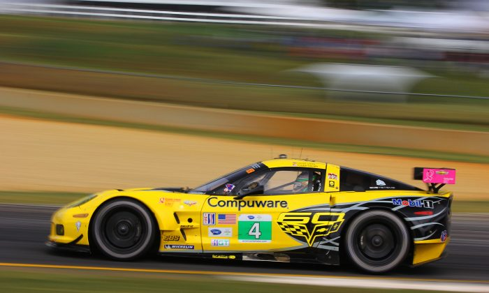 The #4 Corvette of Tom Milner and Olly Gavin steams out of Turn 10a headed to 10b during the afternoon session. (Chris Jasurek/Epoch Times)