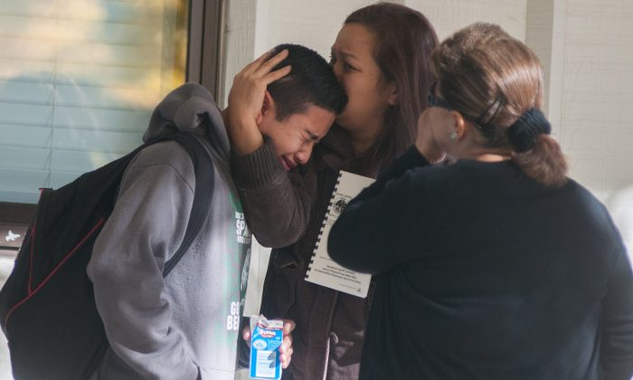 The shooter at Sparks Middle School has been named as Jose Reyes. Here, a Sparks Middle School student cries after being released from Agnes Risley Elementary School, where some students were evacuated to after a shooting at SMS in Sparks, Nev. on Monday, October 21, 2013 in Sparks, Nev. (AP Photo/Kevin Clifford)