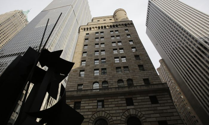 The Federal Reserve Bank of New York building (C) is seen on Aug. 19, 2013. (AP Photo/Mark Lennihan)