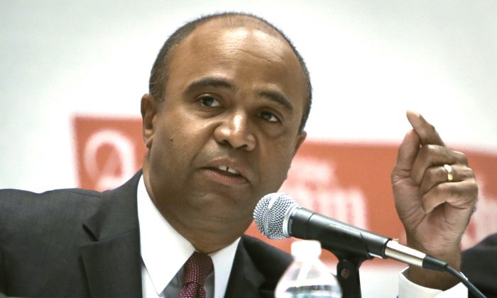 Mayoral hopeful Adolfo Carrion speaks at a forum at Hunter's College, New York City, Aug. 6, 2013. (Bebeto Matthews/AP)