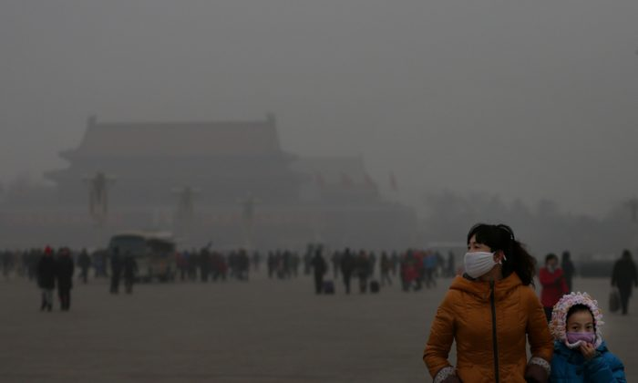 A tourist and her daughter wear masks on Jan. 23 while visiting Tiananmen Square in Beijing. (Feng Li/Getty Images)