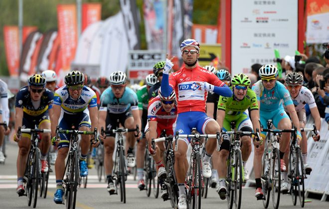 FDJ's Nacer Bouhanni raises two fingers to celebrate his second stage win, after outsprinting his rivals in Stage Three of the Tour of Beijing. (tourofbeijing.net)