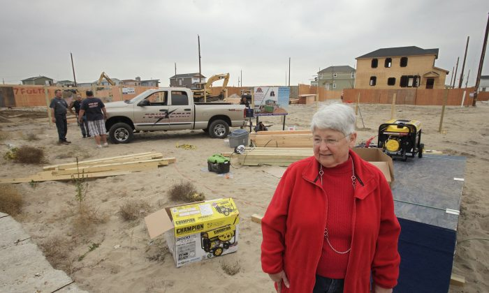"""Marie Lopresti visits the site of her former house in Breezy Point, Queens, New York, Oct. 17, 2013. """"I still dream of my old house,"""" she said. """"I see everything. But you have to look forward. You wish you could go back, but you can't."""" (Mark Lennihan/AP)"""