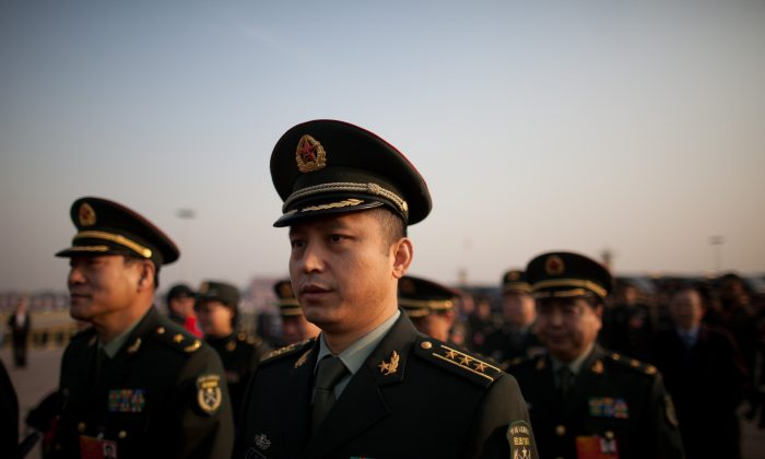 Delegates from the People's Liberation Army (PLA) arrive on Tiananmen Square on March 5. State-sponsored cyberattacks point to the interests of the Chinese military. (Ed Jones/AFP/Getty Images)