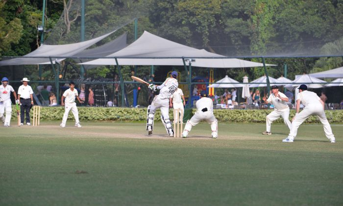 Final bowl of the match … LSW Knights' No.10 batsman hits out against HKCC Scorpions spin bowler Rizwan Raja in their Sunday Championship match on Oct 13, 2013, but is caught at mid-on closing the innings. Scorpions won the match by 93 runs. (Bill Cox/Epoch Times)