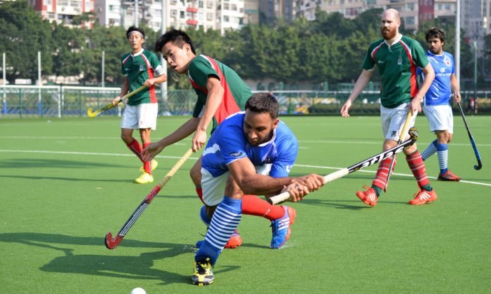 Canadian Olympian hockey player, Sukhwinder Singh Gabba representing Punjab-A hits a shot at goal during their match against KCC-A on Sunday Oct 27, 2013 at the Happy Valley Ground. Punjab-A won the match 3-1 to keep them equal top in the standings. (Bill Cox/Epoch Times)