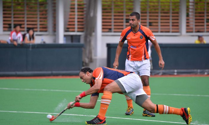 Ahmed Ewis of Khalsa-A drag-flicks their first goal in the thrilling match between Khalsa-A and Shaheen at King's Park on Sunday Sept 29. The match ended in a 5-5 draw. (Bill Cox/Epoch Times)