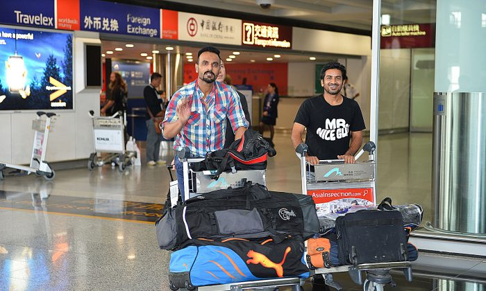 Pakistan Hockey Olympians Sohail Abbas (left) and Waseem Ahmad arrive at Hong Kong International Airport on Sunday Oct 20 to play for the Punjab Sporting Club Team in the Hong Kong Hockey Association Premier League. (Bill Cox/Epoch Times)
