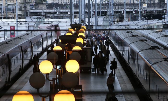 French commuters walk on a platform at Gare du Nord railway station in Paris on Sept. 7, 2010. The French commute is about to get more productive, as France 24 reported in October 2013, with a pilot program that brings English lessons aboard commuter trains. (Pierre Verdy/AFP/Getty Images)