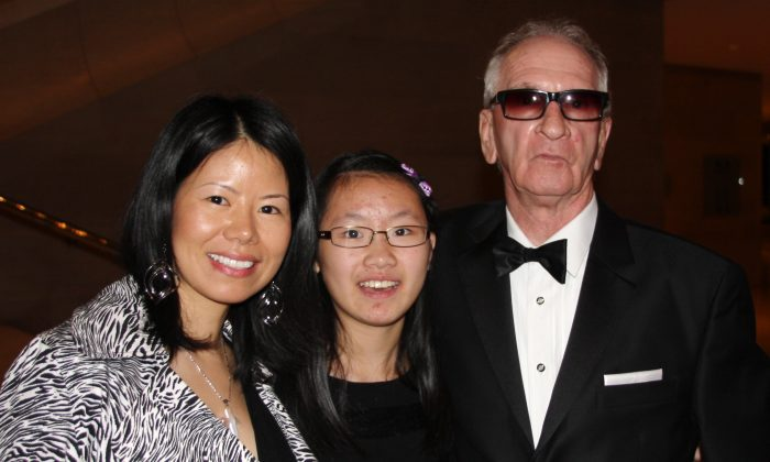 Ms. Sunny Chen, her daughter Ms. Qi Wang, and Mr. Gordon Voegeli enjoyed the performance Shen Yun Symphony Orchestra gave at the Morton H. Meyerson Symphony Center in Dallas, Oct. 15. (Rich Rangel/Epoch Times)