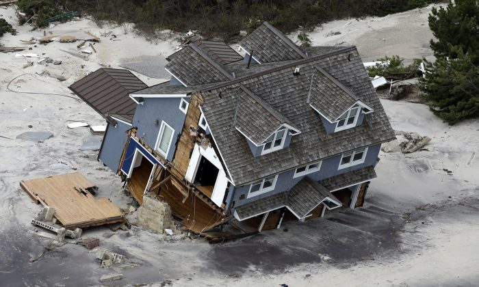 A house along the central Jersey Shore coast was destroyed by Superstorm. New Jersey got the brunt of Sandy, which made landfall in the state on Oct. 29, 2013. (AP Photo/Mike Groll)