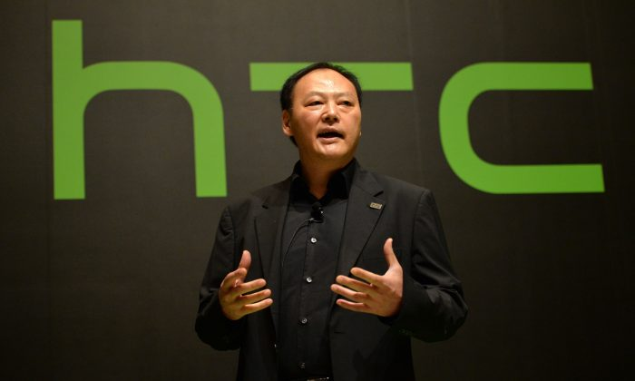 Taiwan's HTC CEO Peter Chou announces the company's new smartphone HTC J One at a launch event in Tokyo on May 20. HTC recently reported losses for the first time since 2002. (YOSHIKAZU TSUNO/AFP/Getty Images)