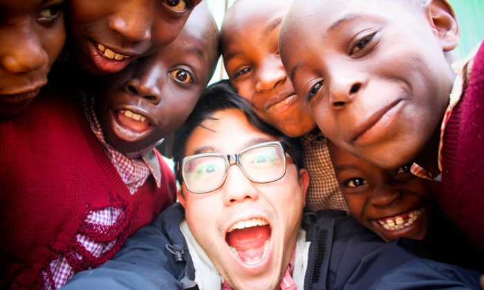 Eddo Kim with children in Kenya. Kim is the founder of The Supply, a non-profit that creates innovative low-cost school models for impoverished communities. (Courtesy of Eddo Kim)