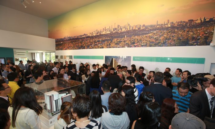 Hundreds of buyers packed the Highpoint development sales office on October 12 in Sydney suburb, Hurstville. According to the developer, Australian company Toga Group, the 18 storey, 437 apartment complex – complete with city views and a rooftop garden managed to sell 240 apartments off the plan on its launch day. (Belinda Pan/Epoch Times)
