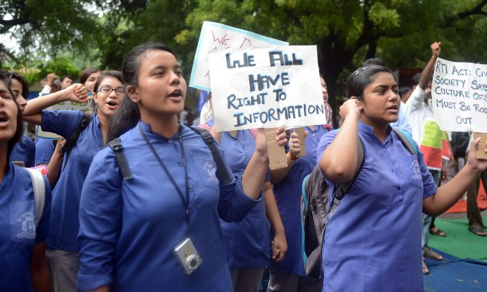 Indian activists shout slogans during a protest against the changes in the Right to Information (RTI) Act near the Parliament in New Delhi, Aug. 6, 2013. (Raveendran/AFP/Getty Images)