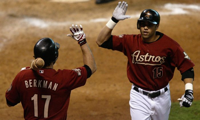Carlos Beltran #15 of the Houston Astros celebrates with teammate Lance Berkman #17 after hitting a home run giving the Astros the lead 6-5 in game four of National League Championship Series during the 2004 Major League Baseball Playoffs on October 17, 2004 at Minute Maid Park in Houston, Texas. (Streeter Lecka/Getty Images)