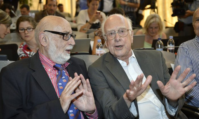 Belgian physicist Francois Englert (L) and British physicist Peter Higgs (R) answer journalist's question about the scientific seminar to deliver the latest update in the search for the Higgs boson at the European Organization for Nuclear Research (CERN) in Meyrin near Geneva, Switzerland, on July 4, 2012.(AP Photo/Keystone/Martial Trezzini, File)