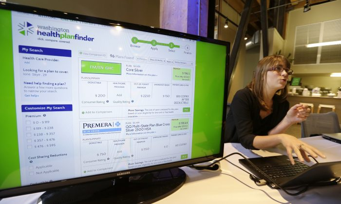 Nelly Kinsella demonstrates the Washington Healthplanfinder website, where consumers will be able to shop for health insurance, following a news conference in Seattle, Monday, Sept. 30, 2013, in Seattle. The new site, which allows consumers to compare and purchase health insurance plans and to see if they are eligible for government subsidies, is Washington state's online answer to the Affordable Care Act, which is available to the public beginning Tuesday. (AP Photo/Elaine Thompson)