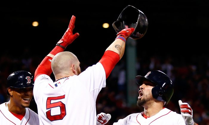 Shane Victorino (R) of Boston celebrates with Jonny Gomes (C) after hitting a grand slam against Jose Veras of Detroit in Game 6 of the ALCS. (Jared Wickerham/Getty Images)