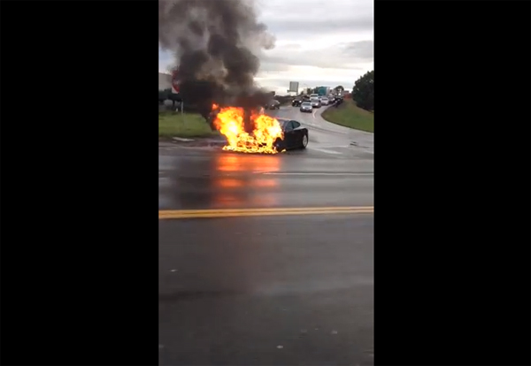A Tesla Model S catches on fire on a highway near Seattle (Screenshot via Youtube)