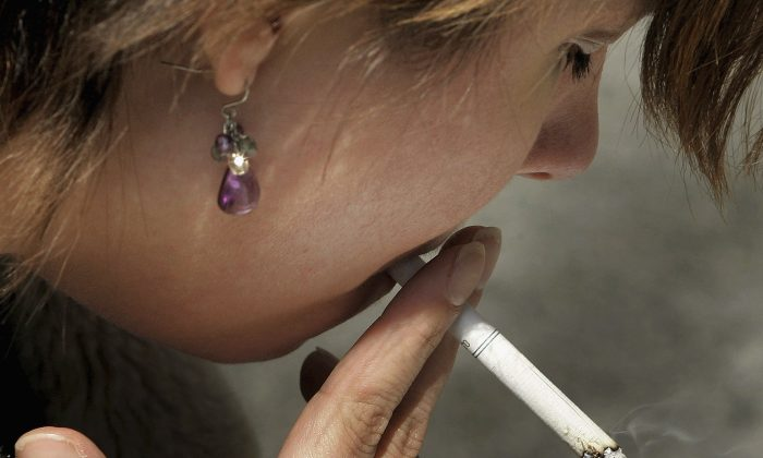 New York City Council voted on Oct. 30, 2013, to raise the minimum legal age to buy tobacco products to 21 to curb the easy supply of cigarettes to young people aged 18–21. (Tim Boyle/Getty Images).