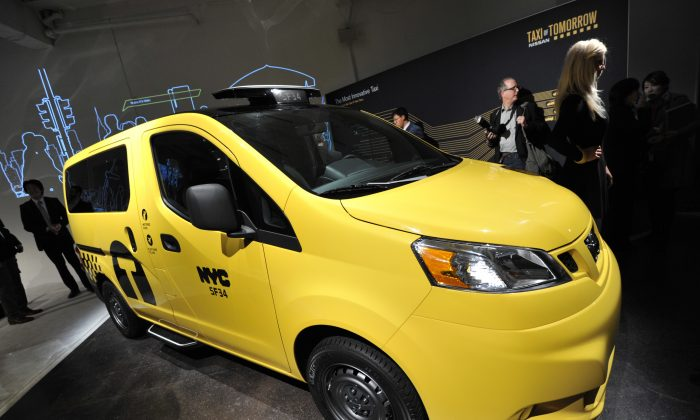 The Nissan NV200, New York's Taxi of Tomorrow, is unveiled on the New York International Automobile Show in New York, April 3, 2012. (Stan Honfa/AFP/Getty Images)