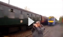 Train Spotter Inches From Being Killed by Train (Video)