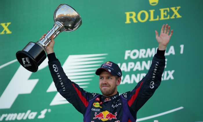 Sebastian Vettel of Red Bull Racing celebrates on the podium after winning the Formula One Japanese Grand Prix at Suzuka Circuit on October 13, 2013 in Suzuka, Japan. (Clive Rose/Getty Images)