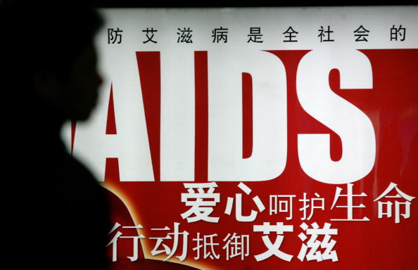An AIDS awareness poster in a Beijing subway station. A new plan proposed by the Chinese Ministry of Commerce would ban people with AIDS from entering public baths or spas, and has raised controversy among activists. (Peter Parks/AFP/Getty Images)
