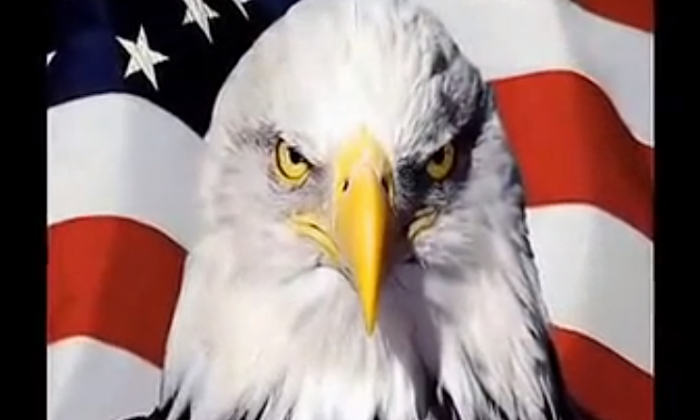 "A screenshot of the film ""Silent Battle"" from the National Defense University,  shows a tough-looking eagle, representing America, with the national flag of the United States in the background. The documentary says that the United States is China's enemy, despite American policy that attempts to prove the contrary. (Screenshot from National Defense University)"