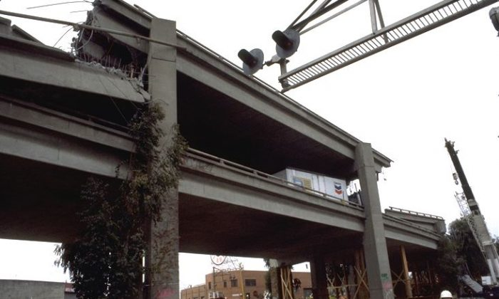 Ground movement during the Loma Prieta Earthquake in California pancaked the upper deck of the Cypress Street Viaduct so that the upper deck dropped to the lower deck. (USGS)