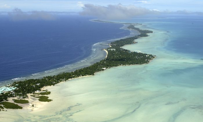 Tarawa atoll, Kiribati, is seen in an aerial view. A Kiribati family is applying for refugee status in New Zealand, saying they are fleeing climate change, which could wipe out low-lying Kiribati, reported the New Zealand Herald Oct. 2, 2013. (AP Photo/Richard Vogel, File)