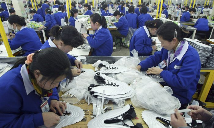 North Korean women work at the assembly line of the factory of shoemaker Samduk Inc. at the Kaesong industrial complex in Kaesong, North Korea, on Feb. 27, 2006. An article published Oct. 6, 2013, in the Korean Herald looked at a Korean man who  has been hand-crafting shoes for 60 years and the history of shoemaking in Korea. (Chung Sung-Jun/Getty Images)