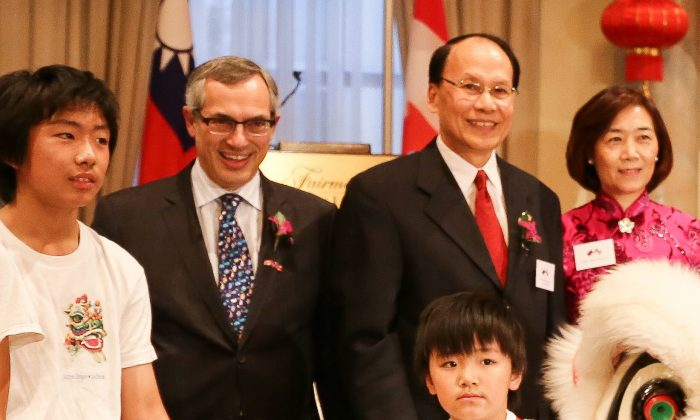 Treasury Board President Tony Clement stands beside Taiwanese representative C.K. Liu and his wife Huey-Pyng Liu with members of a lion dance team Tuesday night at the Fairmont Château Laurier hotel. Liu spoke bluntly about Taiwan's democracy in contrast to the authoritarian status quo in China. (Donna He/Epoch Times)