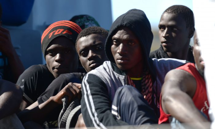 Migrants arrive on a boat of the Armed Forces of Malta after being transferred from the USS San Antonio in Valetta, Malta, Oct. 17, 2013. A U.S. warship has rescued 128 migrants from an inflatable raft that was threatening to capsize in rough seas in the Mediterranean after a request from Malta.  (Matthew Mirabelli/AFP/Getty Images)