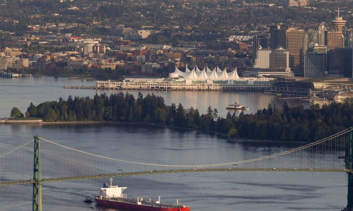 An oil tanker goes under the Lions Gate Bridge as it enters Vancouver Harbour on May 5, 2012. Oil sands opponents who have been fighting the Keystone XL pipeline project in the U.S. are training their sights on two pipeline proposals in B.C. (The Canadian Press/Jonathan Hayward)